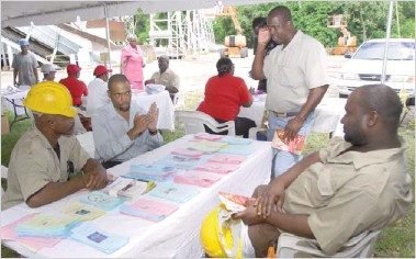 PressReader - Daily Nation (Barbados): 2012-10-30 - Workers given